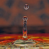 Water drop in beautiful colors. And abstract splash stock images