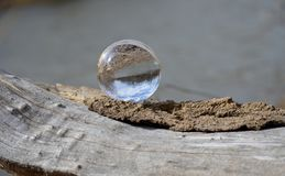 Water Drop on Brown Surface Royalty Free Stock Images