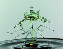 Water Drop Collision. Water drops colliding to create a unique image Royalty Free Stock Images