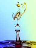 Water Drop Collision. Water drops colliding to create a unique image Stock Photos