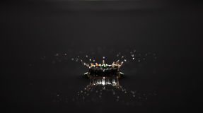 Water drop. Creating waves and ripples in on a dark grey background Royalty Free Stock Images