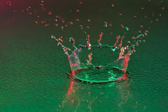 Water drop crown on green surface Royalty Free Stock Photography