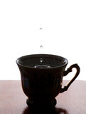 Water drop. Cup of tea with splash. white background. copy space. soft focus, macro view Stock Photo