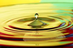 Water drop. S with color background Stock Photo