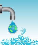 Water drop with earth globe. A water drop containing the globe while falling from a tap Stock Photography