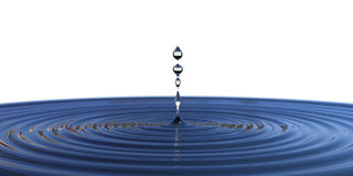 Water drop falling down and isolated on background Royalty Free Stock Photos