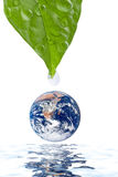 Water drop falling onto earth planet isolated Stock Photography