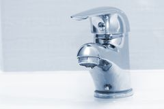 Water drop from a faucet Stock Image