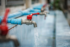 Water drop from faucet Stock Photos