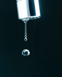 Water drop on faucet Stock Photo