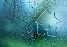 Water Drop Forming a House Royalty Free Stock Images