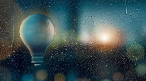 Water Drop Forming a Light Bulb. 3D Rendering Royalty Free Stock Photos