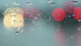 Water drop at front car window in traffic jam. Close up of water and water drop at front car window in traffic jam stock video footage