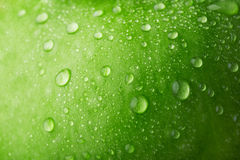 Water drop on green apple Royalty Free Stock Photos