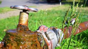 Water drop, leaking from old valve tap. Worn pipeline outside stock video footage