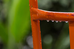 Water drop on metal bar. Close up shot of water drop on metal bar after rain Royalty Free Stock Photography