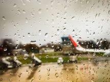 Water drop on mirror window of airplane stock photo