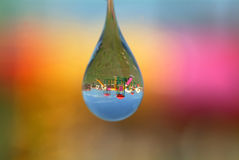 Water drop with playground reflection Stock Photo