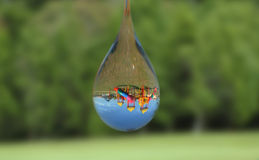 Water drop with playground reflection Royalty Free Stock Images