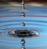 Water drop. A drop of water in a pool Stock Photo