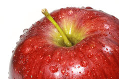 Water drop on red apple surface Stock Photos