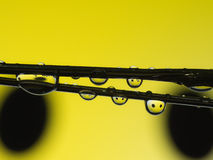 Water drop reflection on yellow smile Stock Images