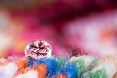Water drop on the scarf. Macro on water drop on a scarf Stock Photo