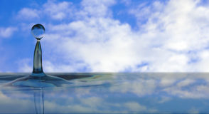 Water drop on sky background Royalty Free Stock Photos