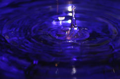 Water Drop Splash in Blue Liquid stock images