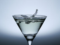 Water Drop Splash  on the Champagne glass. Royalty Free Stock Photo