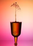 Water drop splash in glass Royalty Free Stock Photo
