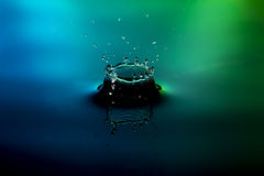 Water drop splash on nice blue green background Stock Photo