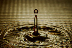Water Drop Splash with Ripples Royalty Free Stock Images