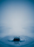 Water drop splash with smooth clean aqua soft focus composition Stock Photography