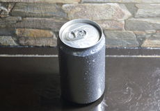 Water drop on tin can drink on black counter Royalty Free Stock Images