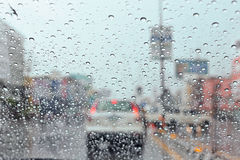 Water drop on traffic jam and electric light in the rain. Royalty Free Stock Photos
