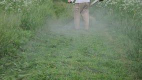 Water drop wet grass cut. Closeup of water rain drops rise from trimmer mow cut wet grass after rain stock video
