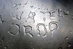 Water Drop written with water Stock Photo