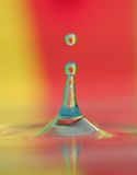 Water Droplet. Colorful image of water droplet in water body stock image