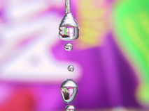 Water Droplet. Macro, background is a colorful fruit juice packaging Royalty Free Stock Image