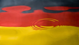 Water droplet against a German flag Royalty Free Stock Photo