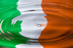 Water droplet against an Irish flag. A water droplet against an Irish flag colors stock photo