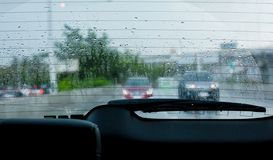 Water droplet on car rear windscreen and wiper stock image