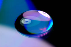 Water droplet on DVD. A water drop on DVD royalty free stock photo