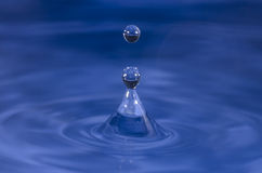 Water droplet splash. Still of a  water a drop splashing Royalty Free Stock Photos