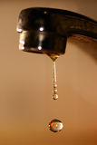 Water droplet from tap Stock Image