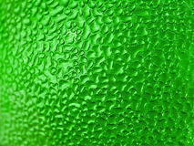 Water Droplets. Formed from condensation inside a green bottle Stock Photo