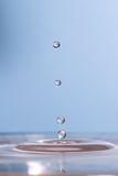 Water droplets. Against a blue colored background Royalty Free Stock Image