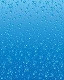 Water droplets. Vector illustration of water droplets on a blue background Stock Images