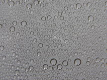 Water droplets (background). Steam condensed into water droplets on grey background Royalty Free Stock Photos